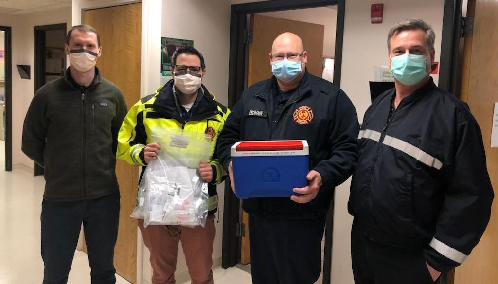 Kenosha Fire Department members pose with initial supply of COVID-19 vaccine