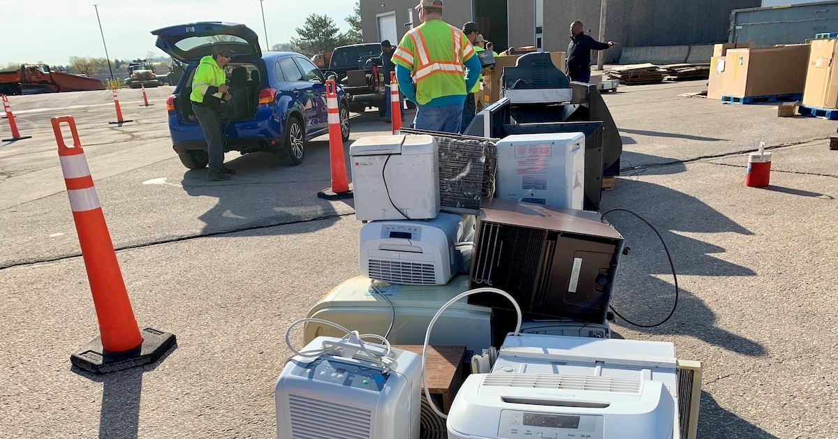 Vehicles lined up to dispose of items at Kenosha County's Household Hazardous Waste collection ev