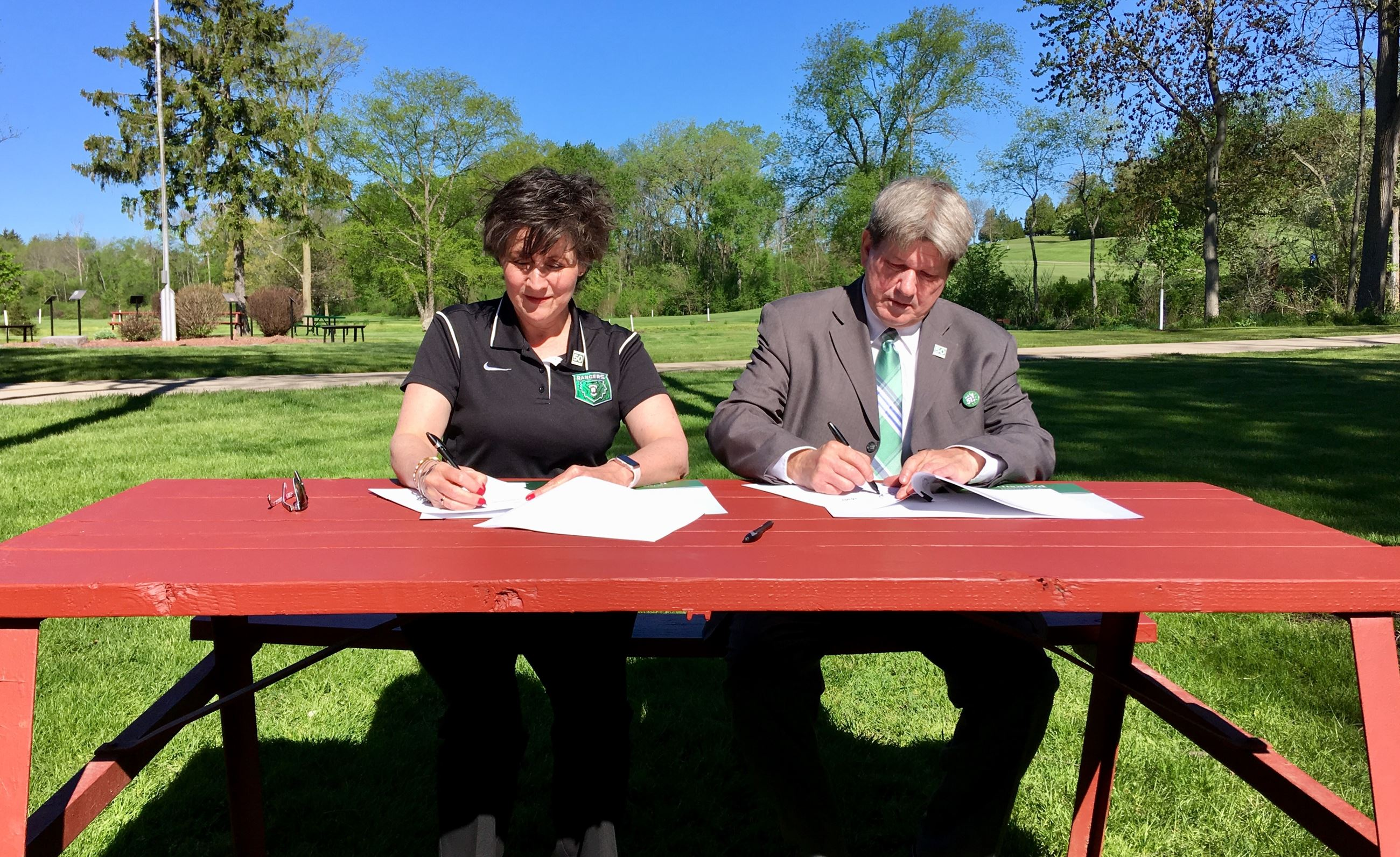 County Executive Jim Kreuser and UW-Parkside Chancellor Debbie Ford sign a collaborative land agreem
